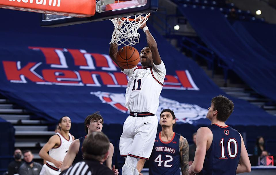 Gonzaga guard Joel Ayayi (11) dunks the ball against Saint Mary's during the second half of their game at McCarthey Athletic Center.