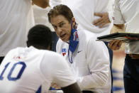 SMU head coach Tim Jankovich talks to his players during a timeout in the second half of an NCAA college basketball game against Houston in Dallas, Sunday, Jan. 3, 2021. (AP Photo/Roger Steinman)