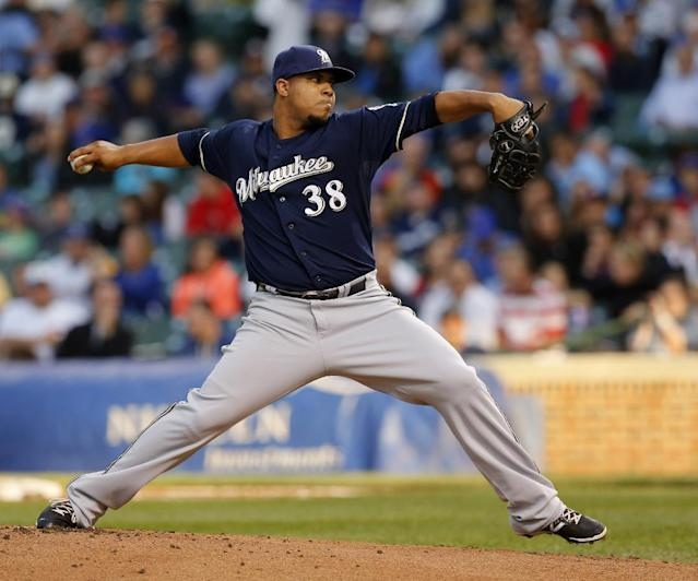 Milwaukee Brewers starting pitcher Wily Peralta delivers during the first inning of a baseball game against the Chicago Cubs Tuesday, Aug. 12, 2014, in Chicago. (AP Photo/Charles Rex Arbogast)