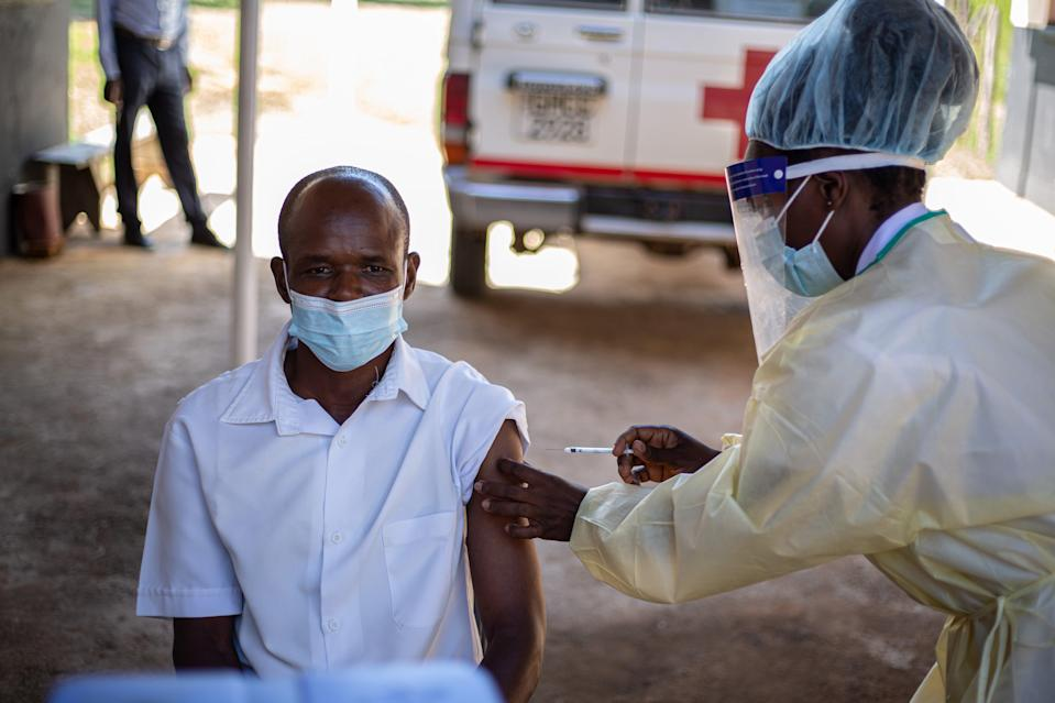 A nurse in Zimbabwe is given the Sinopharm vaccine at a clinic in the Zvimba Rural District (Getty Images)