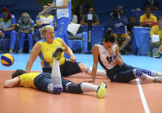 2016 Rio Paralympics - Sitting Volleyball - Women's Bronze Match - Riocentro Pavilion 6 - Rio de Janeiro, Brazil, 17/09/2016. Tetyana Huranska, Ilona Yudina and Larysa Kriukova (UKR) of Ukraine react. REUTERS/Pilar Olivares FOR EDITORIAL USE ONLY. NOT FOR SALE FOR MARKETING OR ADVERTISING CAMPAIGNS.