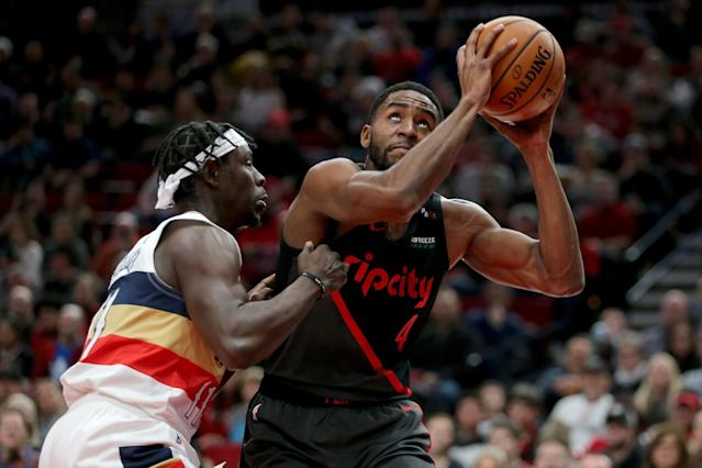 PORTLAND, OR - JANUARY 18: Maurice Harkless #4 of the Portland Trail Blazers takes a shot against Jrue Holiday #11 of the New Orleans Pelicans in the first half during their game at Moda Center on January 18, 2019 in Portland, Oregon. (Photo by Abbie Parr/Getty Images)