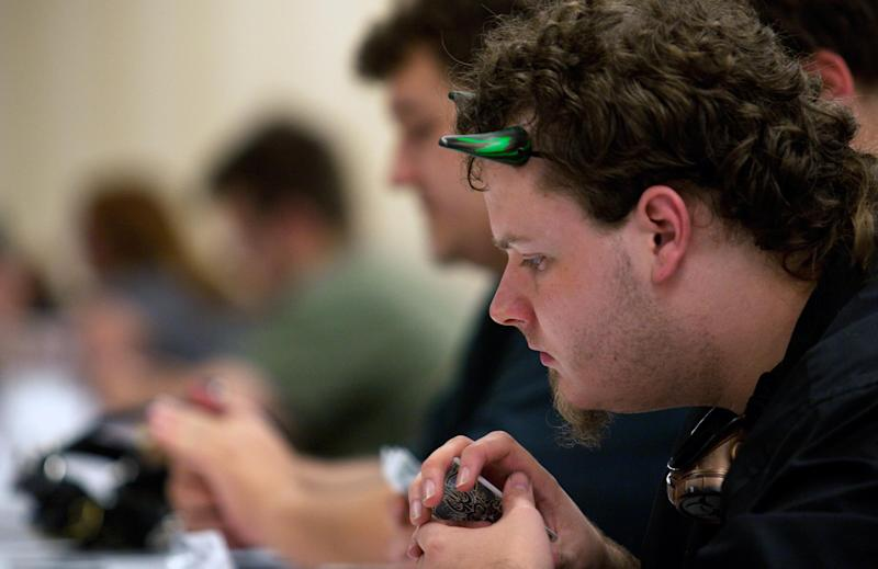 An unidentified attendee concentrates on his next move in the gaming hall at Dragon Con in Atlanta, on Friday, Aug. 31, 2012. The annual science fiction and fantasy convention drew big crowds and had more than 30,000 pre-registered attendees. (AP Photo/Ron Harris)