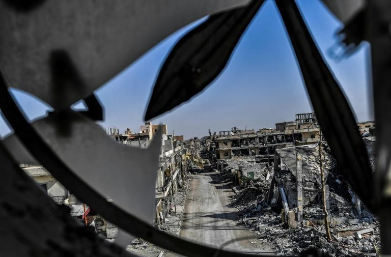A picture taken from Raqa's clock tower shows heavily damaged buildings on October 21, 2017, after US-backed forces expelled the Islamic State (IS) group from the city