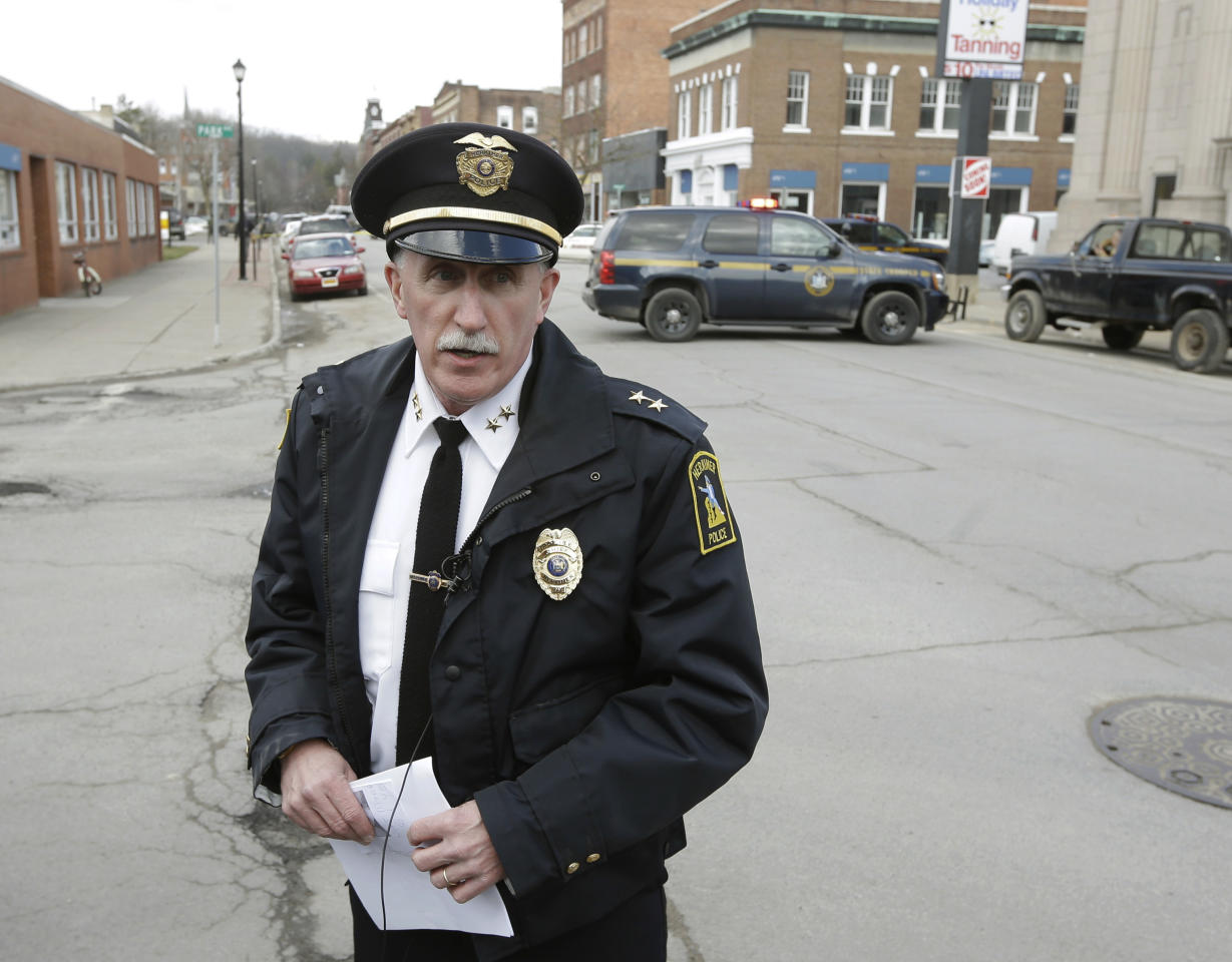 Chief Joseph Malone of the Herkimer Police Department briefs the media on the search for a suspect in two shootings that killed four and injured at least two on Wednesday, March 13, 2013, in Herkimer, N.Y. Authorities were looking for 64-year-old Kurt Meyers, said Malone. Officials say guns and ammunition were found inside his Mohawk apartment after emergency crews were sent to a fire there Wednesday morning. (AP Photo/Mike Groll)