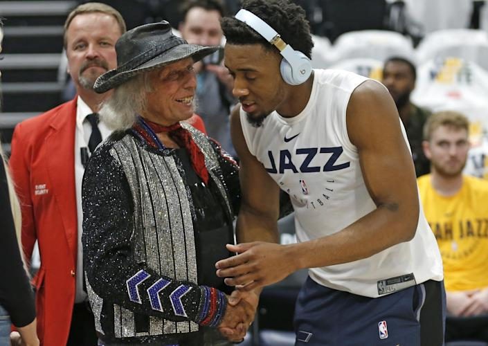 James Goldstein shakes hands with Utah Jazz guard Donovan Mitchell in 2019
