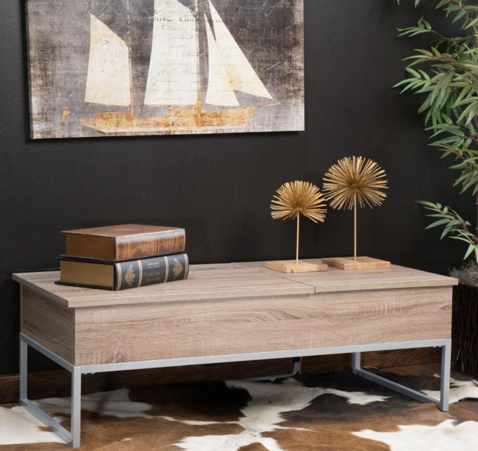 """Not only does this coffee table look modern and minimalist, it offers much more space, too. Lift up the top and find two trays that you can pull out for whenever, like when you want to work from your laptop on the couch.<a href=""""https://fave.co/35pAJac"""" target=""""_blank"""" rel=""""noopener noreferrer"""">Originally $279, get it now for $230 at The Home Depot</a>."""