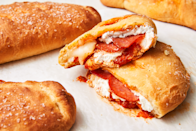 """<p>Pizza doesn't deserve <em>all</em> the hype. Calzones deserve more love. </p><p>Get the recipe from <a href=""""https://www.delish.com/cooking/recipe-ideas/a26091626/easy-calzone-recipe/"""" rel=""""nofollow noopener"""" target=""""_blank"""" data-ylk=""""slk:Delish"""" class=""""link rapid-noclick-resp"""">Delish</a>.</p>"""