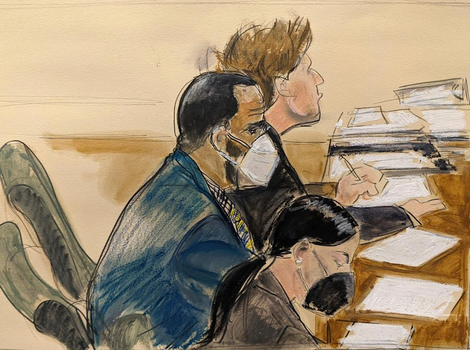 In this courtroom artist's sketch, R. Kelly, center, listens during his trial in New York on Aug. 26, 2021.