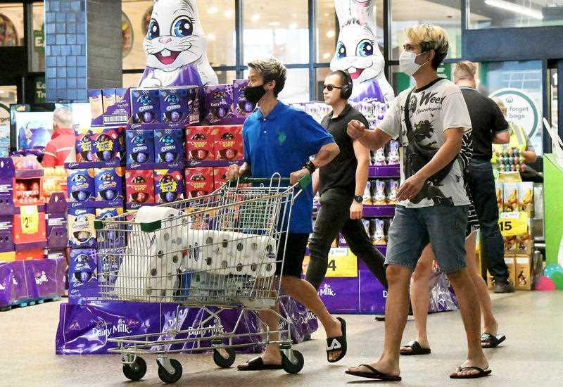 Brisbane residents are seen exiting a grocery store in Brisbane.
