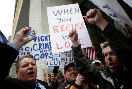 Fraternal Order of Police supporters protest the handling of the Jussie Smollett case by the State's Attorney Kim Foxx in Chicago