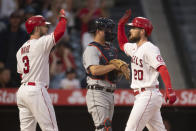 Los Angeles Angels' Jared Walsh, right, and Taylor Ward celebrates Walsh's two-run home run during the third inning of the team's baseball game against the Detroit Tigers in Anaheim, Calif., Saturday, June 19, 2021. (AP Photo/Kyusung Gong)