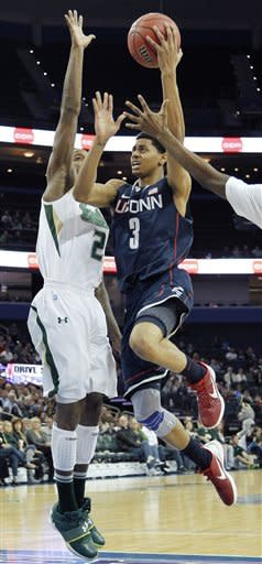 Connecticut guard Jeremy Lamb (3) goes to the basket in front of South Florida forward Victor Rudd (2) during the first half of an NCAA college basketball game Wednesday Dec. 28, 2011, in Tampa, Fla. (AP Photo/Chris O'Meara)