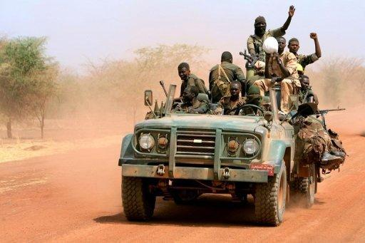 Sudanese soldiers ride in a military vehicle in the oil region of Heglig in April 2012
