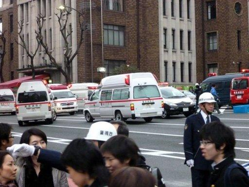 Ambulances gather outside Kudan Kaikan hall where the ceiling of a school collapsed amid the massive 8.9-magnitude earthquake which rocked Tokyo on Friday. The massive earth tremor has unleashed a monster 10-metre high tsunami that sent ships crashing into the shoreline and carried cars through the streets of coastal towns