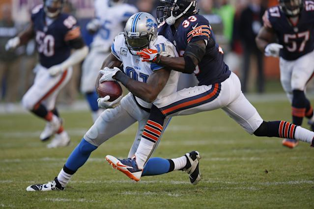 Detroit Lions wide receiver Calvin Johnson (81) runs against Chicago Bears cornerback Charles Tillman (33) during the second half of an NFL football game, Sunday, Nov. 10, 2013, in Chicago. (AP Photo/Charles Rex Arbogast)