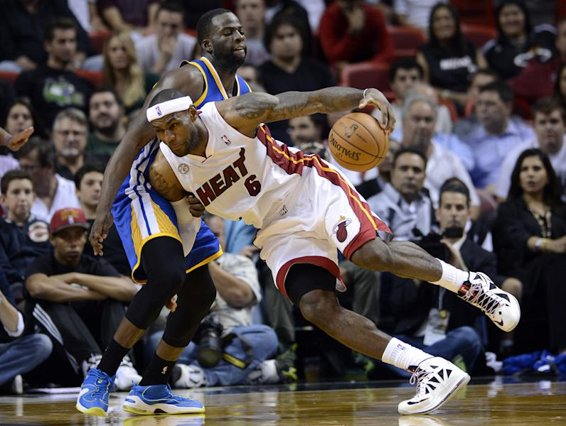 Miami Heat's LeBron James (6) is defended by Golden State Warriors' Draymond Green,left, during an NBA basketball game on Wednesday, Dec. 12, 2012, in Miami. The Warriors won 97-95. (AP Photo/Rhona Wise)