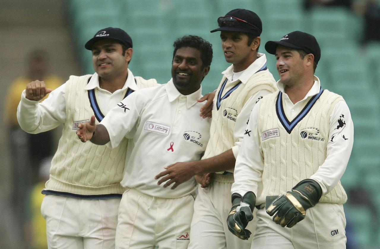 SYDNEY, NSW - OCTOBER 14:  Muttiah Muralitharan of the ICC World XI is congratulated by team-mates after dismissing Matthew Hayden of Australia during day one of the Johnnie Walker Super Series Test between Australia and the ICC World XI played at the Sydney Cricket Ground on October 14, 2005 in Sydney, Australia.  (Photo by Mark Kolbe/Getty Images)
