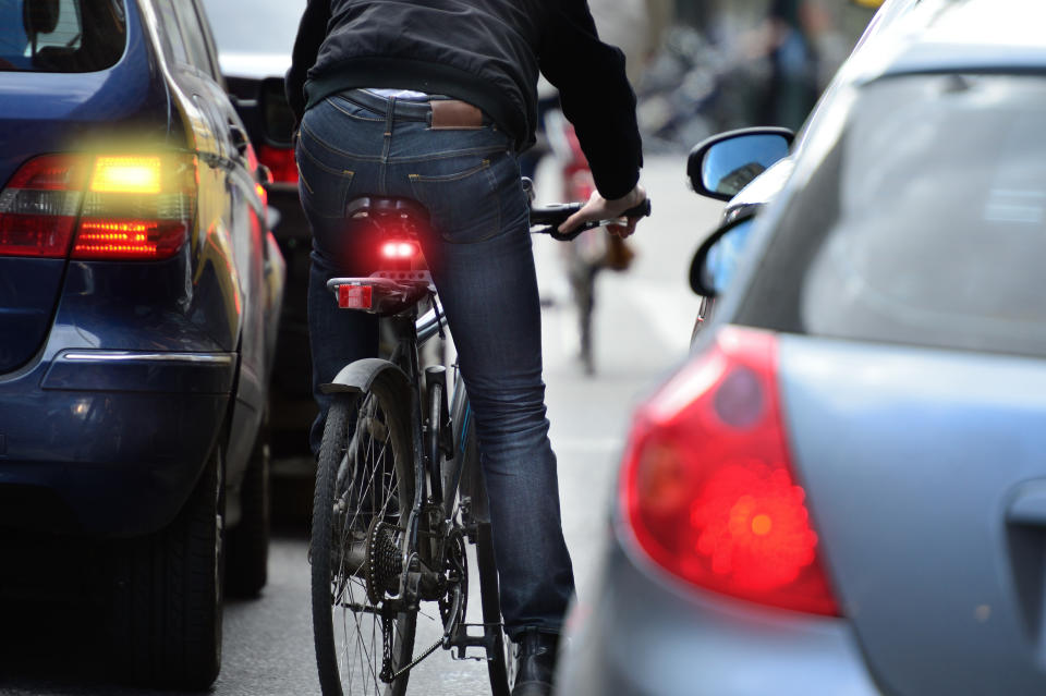 Cyclist in heavy traffic. Source Getty Images