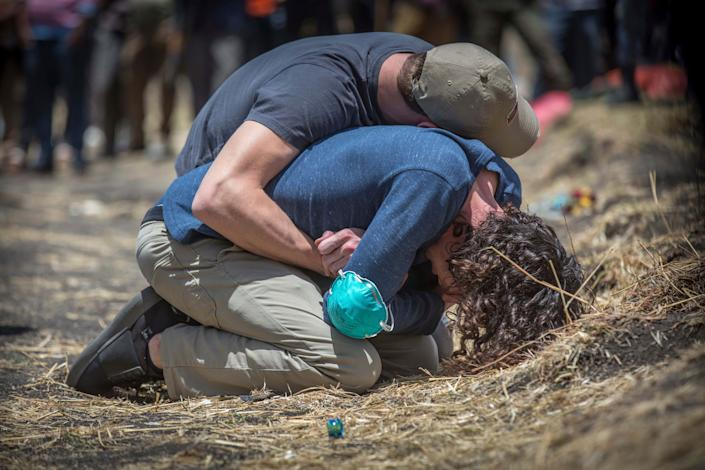 Relatives react at the scene where the Ethiopian Airlines Boeing 737 Max 8 crashed shortly after takeoff on Sunday killing all 157 on board, near Bishoftu, south of Addis Ababa, in Ethiopia, March 13, 2019. (Photo: Mulugeta Ayene/AP)