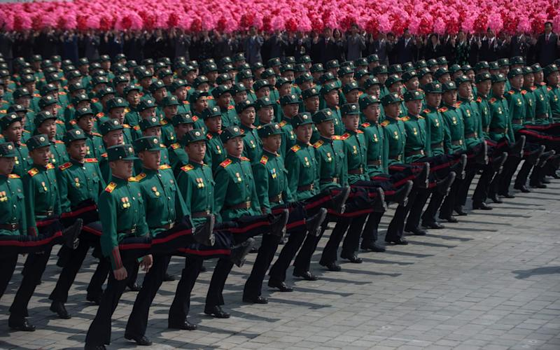 Korean People's Army (KPA) soldiers march on Kim Il-Sung sqaure during a military parade marking the 105th anniversary of the birth of late North Korean leader Kim Il-Sung - Credit:  AFP