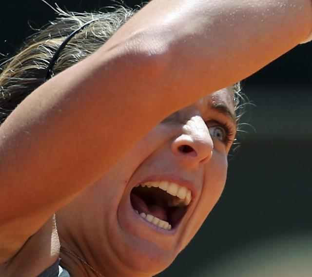 Italy's Sara Errani celebrates after winning her semifinal match against Serbia's Jelena Jankovic at the Italian open tennis tournament in Rome, Saturday, May 17, 2014. Sara Errani became the first home player to reach the Italian Open final in nearly 30 years with a 6-3, 7-5 win over sixth-seeded Jelena Jankovic on Saturday. (AP Photo/Gregorio Borgia)