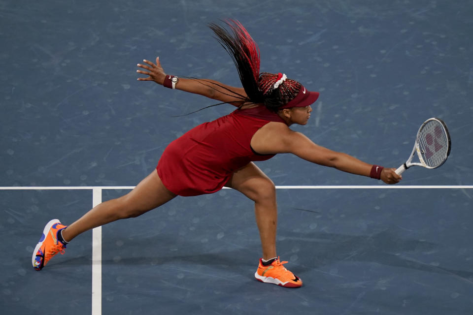Naomi Osaka, of Japan, reaches for a shot by Marketa Vondrousova, of the Czech Republic, during the third round of the tennis competition at the 2020 Summer Olympics, Tuesday, July 27, 2021, in Tokyo, Japan. (AP Photo/Seth Wenig)