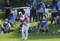 Paul Casey of Great Britain chips onto the 9th green during the final round of the men's golf event at the 2020 Summer Olympics on Sunday, Aug. 1, 2021, in Kawagoe, Japan. (AP Photo/Andy Wong)