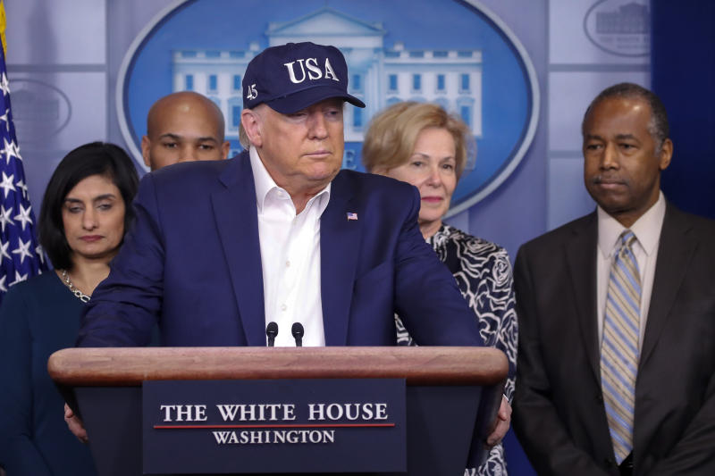 President Donald Trump speaks during a briefing on coronavirus in the Brady press briefing room at the White House, Saturday, March 14, 2020, in Washington. Listening from left are Administrator of the Centers for Medicare and Medicaid Services Seema Verma, U.S. Surgeon General Jerome Adams, Dr. Deborah Birx, White House coronavirus response coordinator, and Housing and Urban Development Secretary Ben Carson. (AP Photo/Alex Brandon)