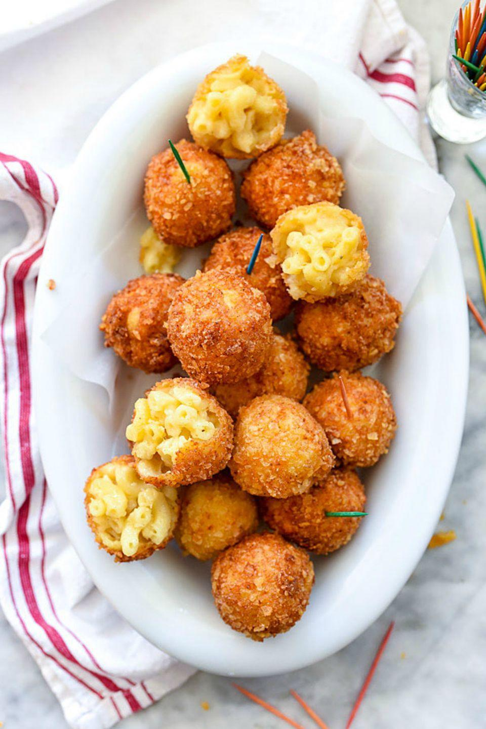 "<p>To make this crowd pleasing treat, coat balls of mac 'n cheese with breadcrumb mix and fry until golden brown. </p><p><strong>Get the recipe at <a href=""http://www.foodiecrush.com/mac-and-cheese-balls-recipe/#"" rel=""nofollow noopener"" target=""_blank"" data-ylk=""slk:Foodie Crush"" class=""link rapid-noclick-resp"">Foodie Crush</a>. </strong></p>"