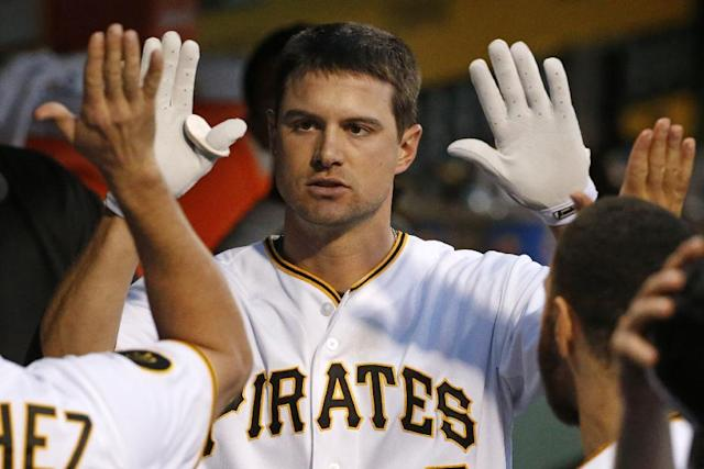 Pittsburgh Pirates' Jordy Mercer (10) celebrates with teammates in the dugout after hitting a solo home run off Milwaukee Brewers starting pitcher Kyle Lohse during the fifth inning of a baseball game in Pittsburgh Friday, June 6, 2014. (AP Photo/Gene J. Puskar)