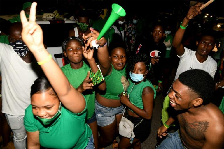 Jamaica Labour Party supporters celebrate their election win over the People's National Party