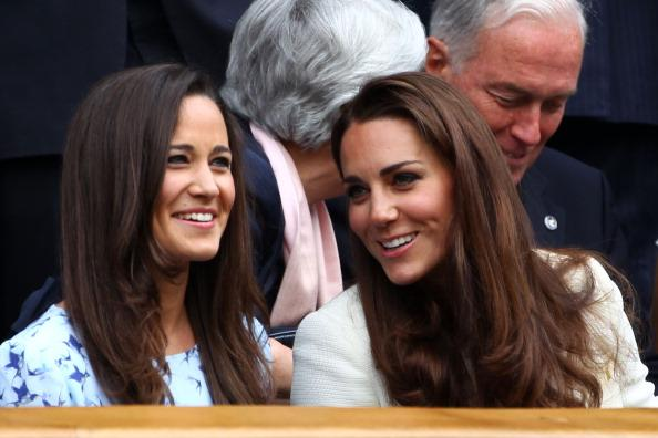 Pippa Middleton (L) and Catherine, Duchess of Cambridge sit in the Royal Box during the Gentlemen's Singles final match between Roger Federer of Switzerland and Andy Murray of Great Britain on day thirteen of the Wimbledon Lawn Tennis Championships at the All England Lawn Tennis and Croquet Club on July 8, 2012 in London, England. (Photo by Clive Brunskill/Getty Images)
