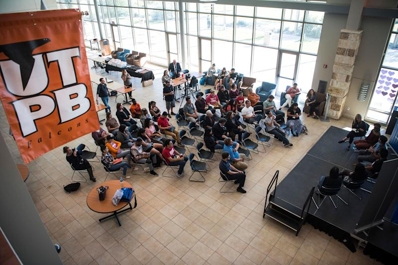 Audience members listen to a talk at the University of Texas of the Permian Basin Student Activity Center.