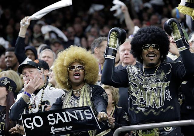 Fans cheer during the first half of an NFC championship game between the Saints and Rams. (AP)