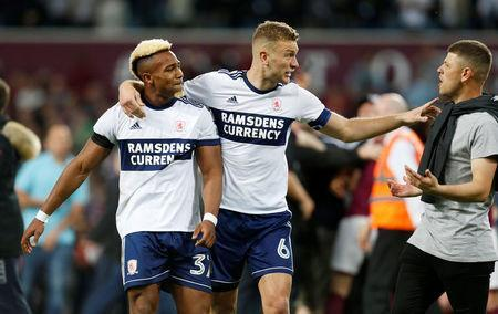 Soccer Football - Championship Play Off Semi Final Second Leg - Aston Villa v Middlesbrough - Villa Park, Birmingham, Britain - May 15, 2018 Middlesbrough's Adama Traore and Ben Gibson look dejected as a fan looks on after the match. Action Images via Reuters/Ed Sykes