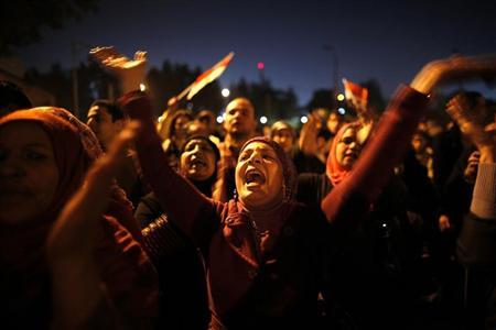 Protesters opposing Egypt's President Mohamed Mursi shout slogans as they demonstrate in front of the presidential palace in Cairo