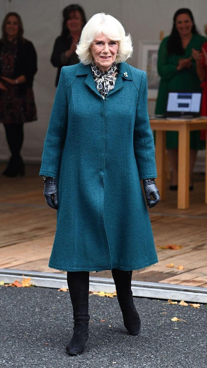 <p>During the Duchess and Prince Charles's visit to Northern Ireland, Camilla met with staff, supporters and service users at the Belfast & Lisburn Women's Aid organization. For this day of appearances, the Duchess chose a teal coat, patterned scarf, and black boots. </p>