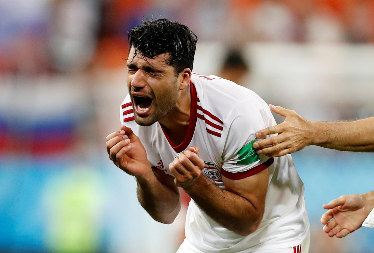 <p>Iran's Mehdi Taremi reacts after the match. REUTERS/Murad Sezer </p>