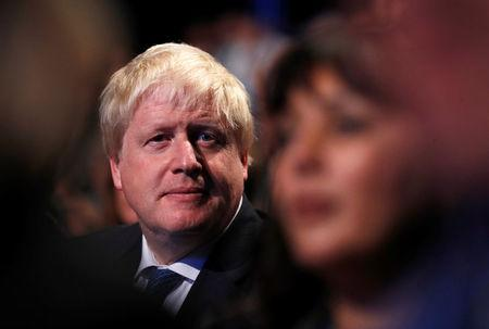 Britain's Foreign Secretary Boris Johnson sits in the auditorium at the Conservative Party conference in Manchester, Britain October 3, 2017. REUTERS/Phil Noble