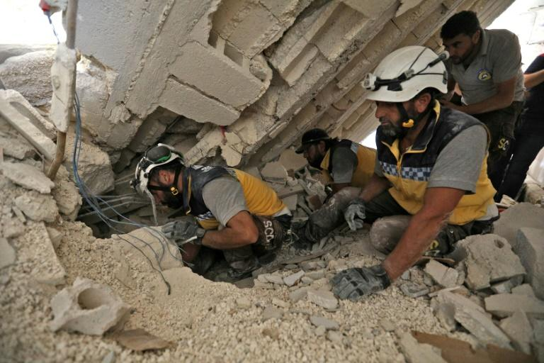 Rescuers searched for victims after fresh air strikes in Idlib province (AFP Photo/Omar HAJ KADOUR)