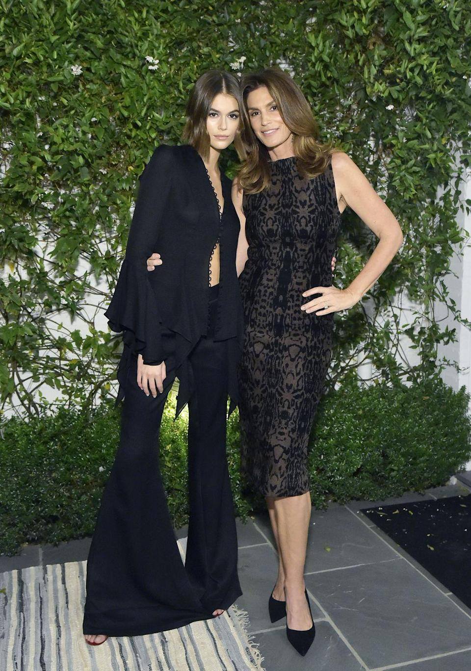 <p>The 18-year-old and 53-year-old supermodels coordinated in black ensembles for a gala in Beverly Hills on 1 November. The famous mother wore a black patterned over-the-knee midi dress which she teamed with a leather jacket and black pointed pumps. Meanwhile, Kaia sported a black scallop-trimmed blouse which she paired with with matching wide-legged pants and a white oversized blazer.</p>