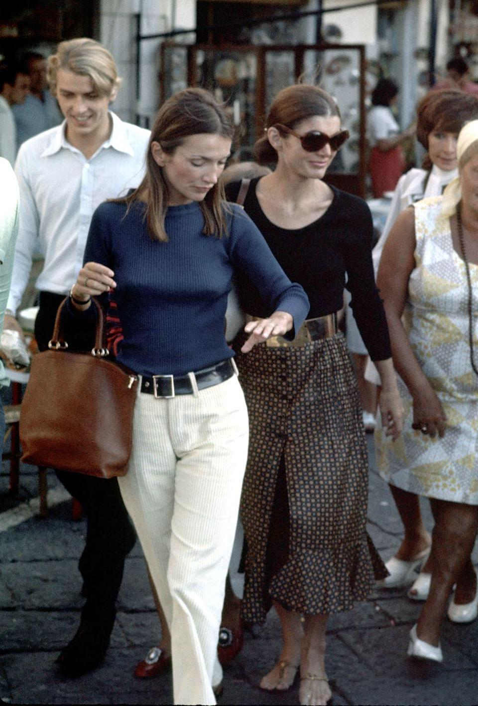 <p>Jackie and her sister, Lee Radziwill, take their children on a shopping trip in Capri, Italy. </p>