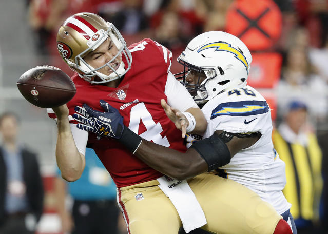 The San Francisco 49ers' Nick Mullens fumbles as he is sacked in a preseason game earlier this year. (AP)