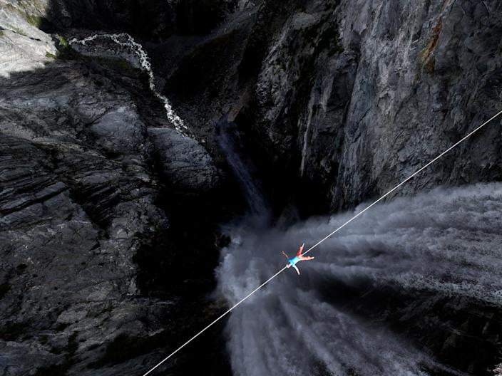 Lukas Irmler takes a break on a high wire across Hunlen Falls in British Columbia, Canada. (Photo: Valentin Rapp/Caters News)