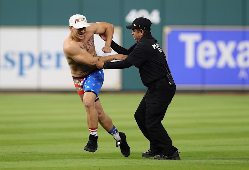 Security apprehends a man during Game 5 of the 2017 World Series between the Houston Astros and the Los Angeles Dodgers on Oct. 29, 2017, in Houston, Texas. (Christian Petersen/Getty Images)