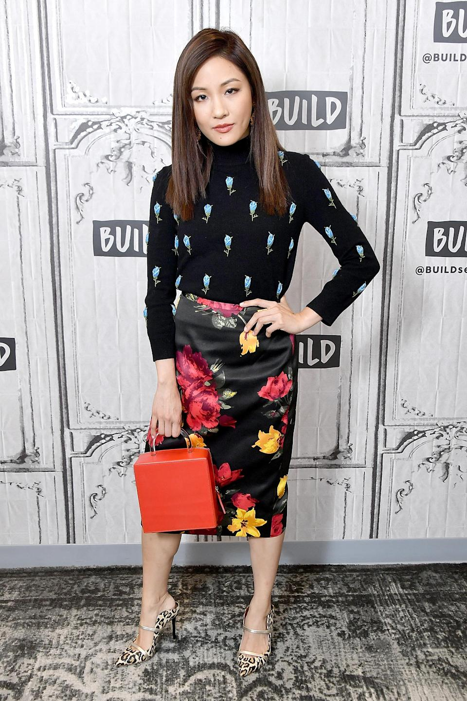 <p>'Crazy Rich Asians' star Constance Wu mixed prints with a block colour bag at BUILD in NYC this month. <em>[Photo: Getty]</em> </p>