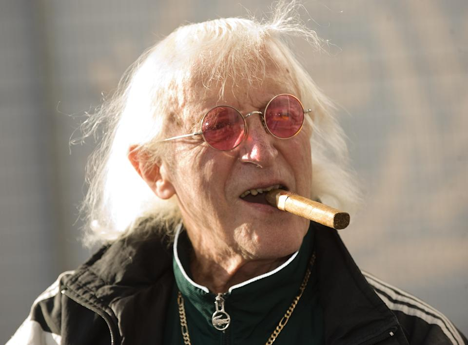 Sir Jimmy Savile attends the ceremony to name Cunard's new cruise-liner Queen Elizabeth II in Southampton Docks in Southampton, England.