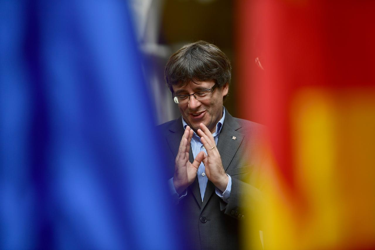<p>Catalan president Carles Puigdemont gestures during an AFP interview in Girona on Sept. 30, 2017. The mission was entrusted to him almost by accident, but he accomplished it with determination. Deaf to the warnings of Madrid, the Catalan regional president Carles Puigdemont is determined to organize a referendum on Oct.1, 2017, hoping to fulfill his dream of youth: an independent Catalonia. (Photo: Pierre-Philippe Marcou/AFP/Getty Images) </p>