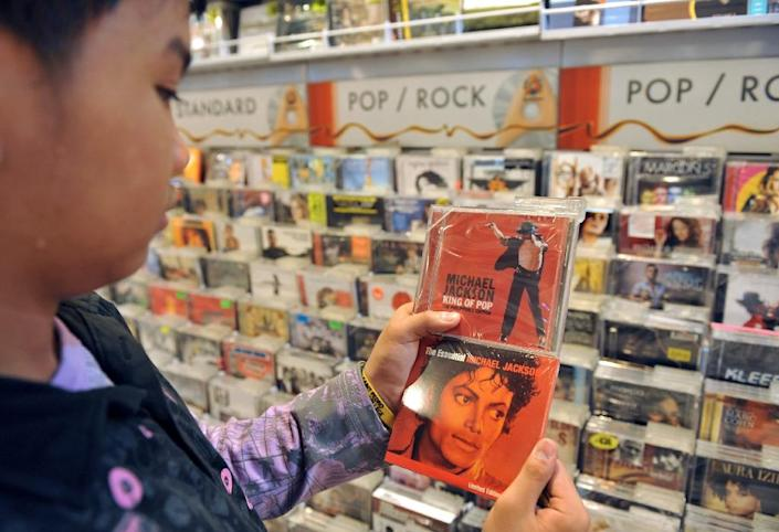 Key groups representing music retailers, record companies and artists said that they would coordinate album releases to go out everywhere each Friday at one minute past midnight local time (AFP Photo/Ted Aljibe)